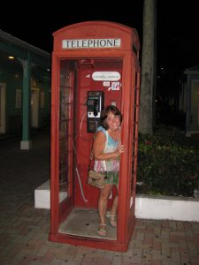Photo of Dr. Jodie standing in a phone booth