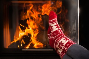 Toasty socks and a roaring fire are part of hygee for happiness